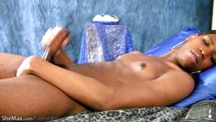 Pretty face ebony ts inserts a butt plug and cums all over