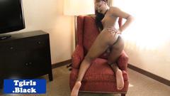 Black tgirl strips and tugs her hard rod