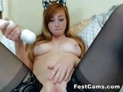 Ginger kitty playing with toys