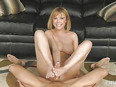 Cutie rides him hard on the couch and gives a footjob