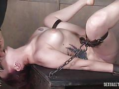 Naughty slave has two huge dicks inside her