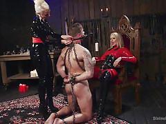 Slave serves mistress with strapon mask