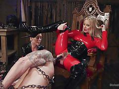 Slave serves mistress with strapon mask