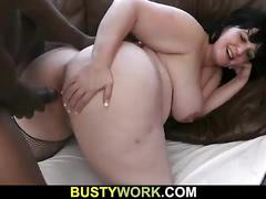 Busty bitch in fishnets swallows giant black meat