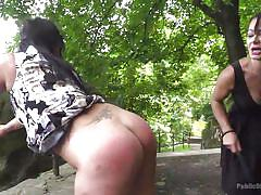 Subs get spanked at the park and please their master