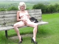 Sexy granny in heels outside