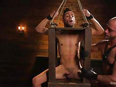 Bound gay slave fully erect while in pain