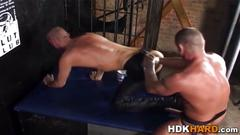 Muscly hunk fists ass