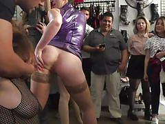 Sub kneels down and serves customers at the local sex shop