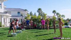 Swingers having fun outdoors in reality show