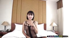 Ladyboy with an incredible pretty face gives a blowjob