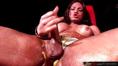 Horny tranny fondles big tits while ass fingering with mango