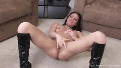 Beauty masturbates in her boots and thongs