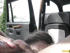 Blonde milf jerks the taxi driver with her feet