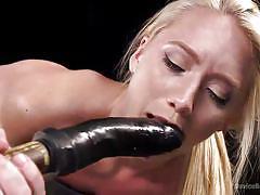 Pushing a big dildo up the sub virgin ass