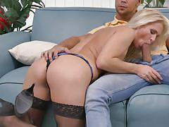 Blonde milf sucks off a hard cock on the sofa