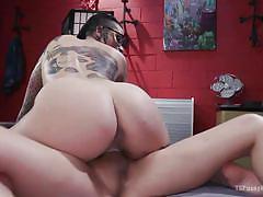 Tattoed babe rides feminine transexual cock