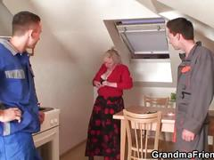 Old women pleases two repairmen