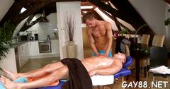 Gay hunk gets oiled up and fucked by his masseur