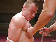 Blowjob with nipple clamps for the gay wrestling loser
