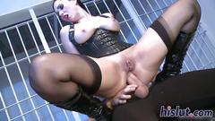 Latex-clad harlot rides a massive meat pole