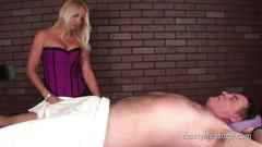 Dominant masseuse amber strokes a cock