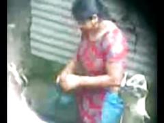 Secretly recorded mms of a village aunty taking a bath captured by a voyeur - play indian porn