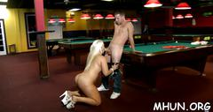 A blonde bombshell gets pounded hard by a hot stud at the pool table
