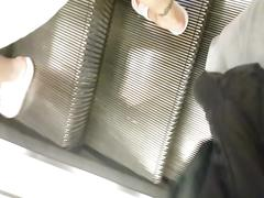 Escalator upskirt blonde mom