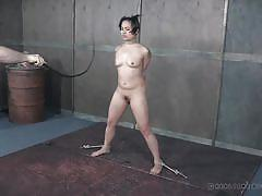 Small titted brunette punished hard in the dungeon