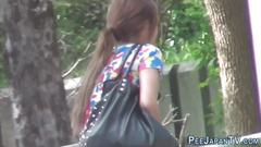 Voyeur watching an asian slut while pissing in public