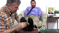 Handsome stud tied up by a boss who has a foot fetish