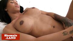 Alluring black inked trans solo pulling cock