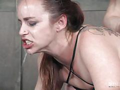 Submissive fuckpig spitroasted on bdsm cross