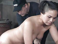 Innocent looking asian brunette taking a rough spanking