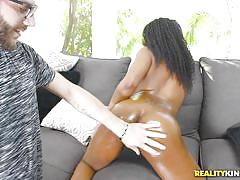 Ebony hottie enjoys sucking on big vanilla balls