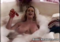 Busty heather playing her pussy on bathtub