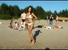 Public voyeur video is showing a hot chick lying on nudist beach