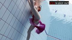 Smoking hot russian redhead ala in the pool