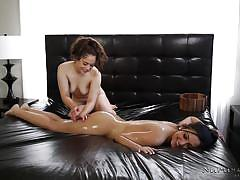 Lesbian nuru massage leads to slick pussy-licking in bed