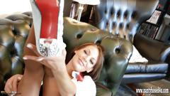 Horny redhead teases in shirt and tie with tan pantyhose and heels as she plays with her wet pussy