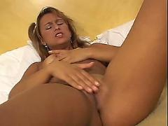 Nice girl masturbates in bedroom