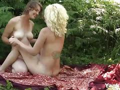 Sexy lesbians fingering their slick cunts outdoors