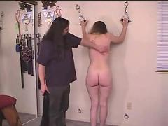 Curvy girl is restrained and caned.