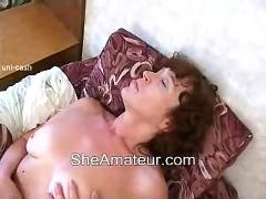 Horny mother wakes up her young son
