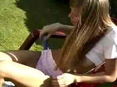 Nice teen playing alone in garden