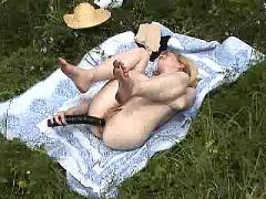 Pale blonde toying outdoor