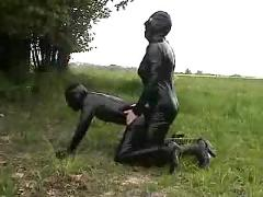 Fetish latex couple have a nice fuck outdoor