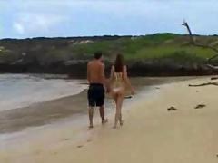 Teen couple on the beach.f70