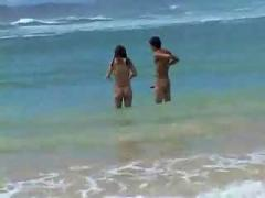 Teen couple on the beach.f70